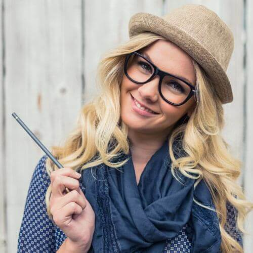 Woman Holding a Pencil Smiling With Glasses